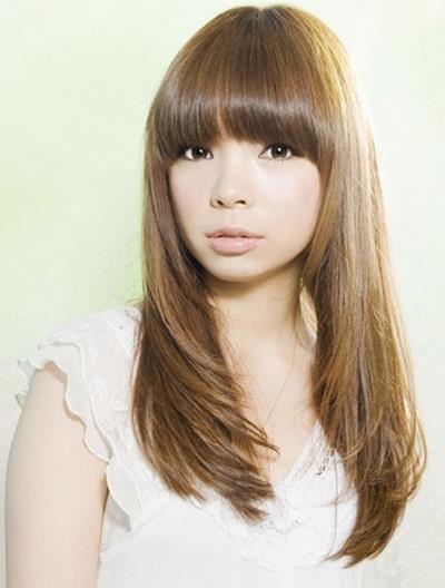 长脸女生适合长卷发 减龄发型时尚气质