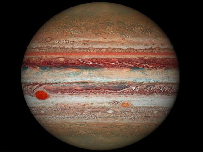 """藏在木星奇异""""彩带""""下的是什么?科学家对此有了新解释"""